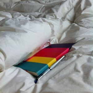 striped notebook in bed